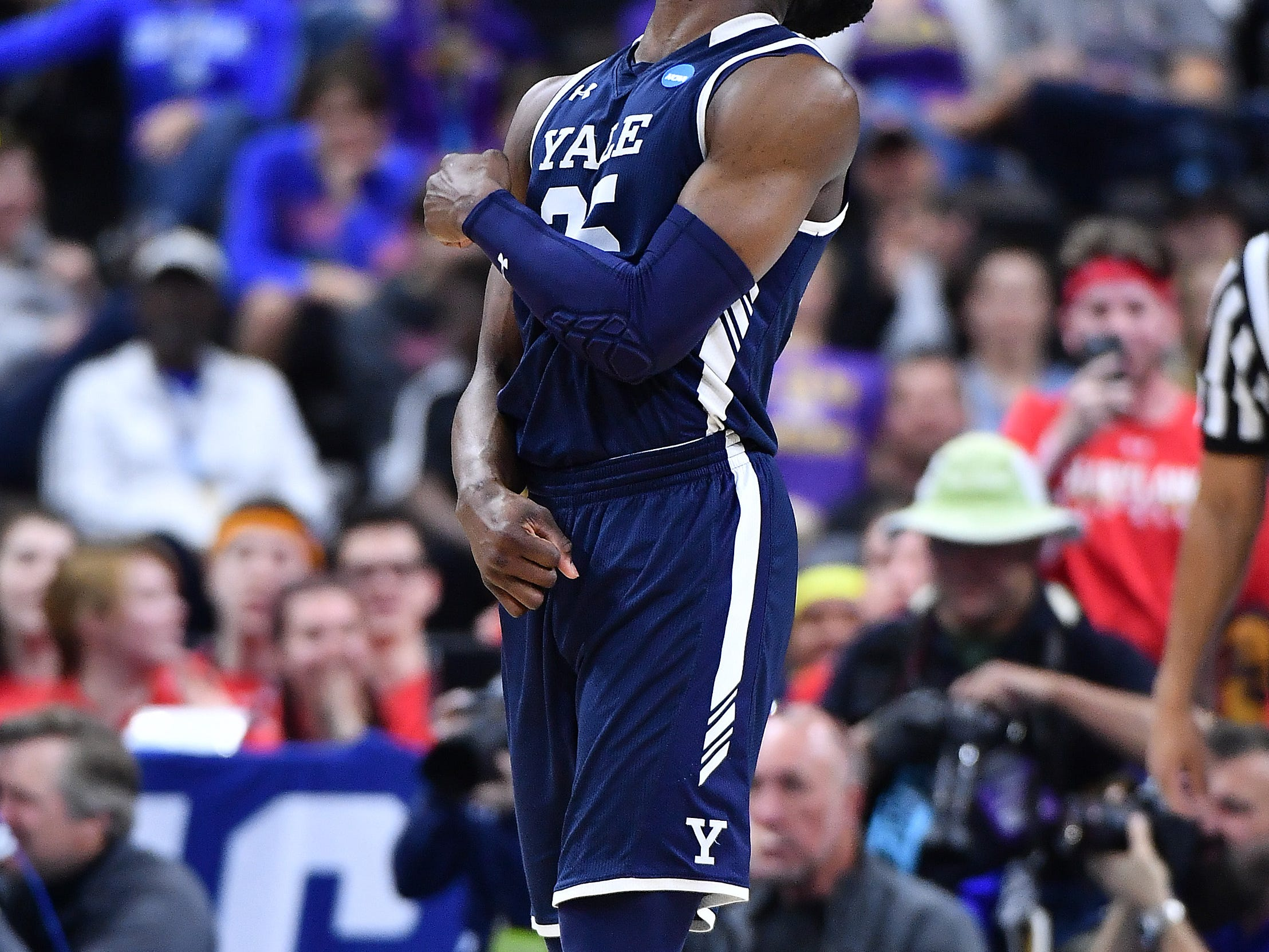 Mar 21, 2019; Jacksonville, FL, USA; Yale Bulldogs guard Miye Oni (25) reacts after a play against the LSU Tigers during the second half in the first round of the 2019 NCAA Tournament at Jacksonville Veterans Memorial Arena. Mandatory Credit: John David Mercer-USA TODAY Sports
