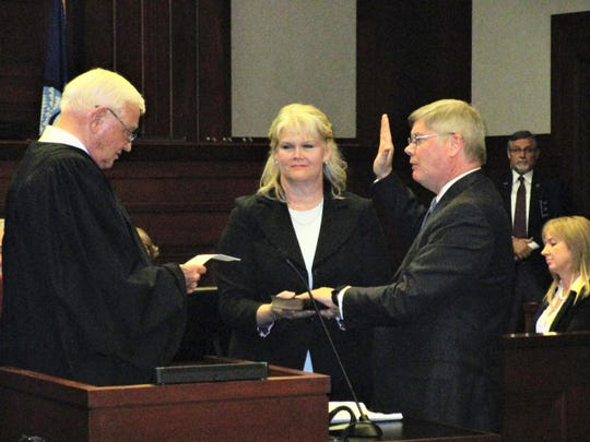 U.S. District Judge Gene Davis administers the oath to Robert Summerhays, the new federal judge for the Western District of Louisiana, as Summerhays' wife, Kim, holds the Bible.
