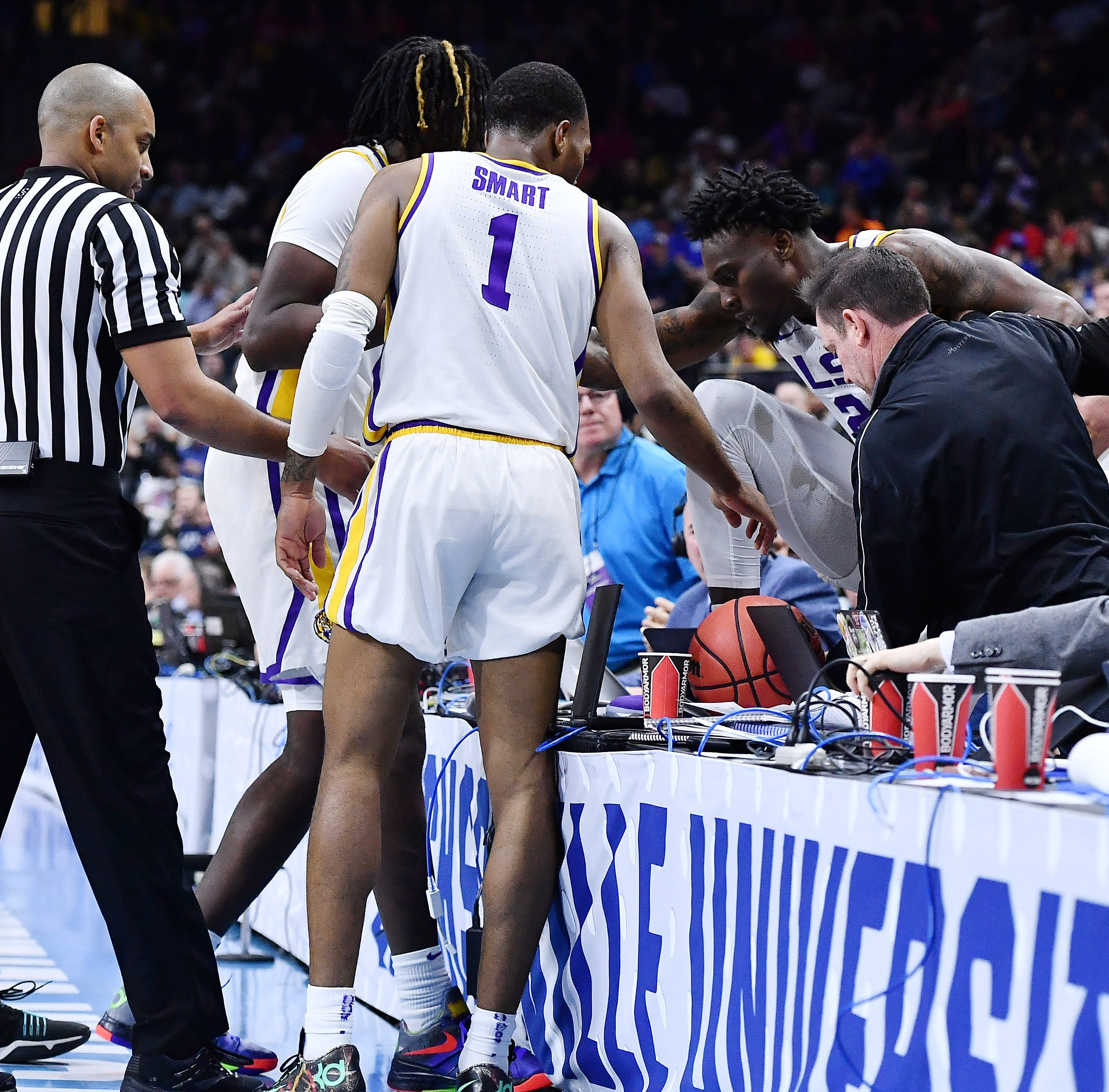 'I was trying to hit the brakes,' said LSU's Williams, who failed and landed on press row