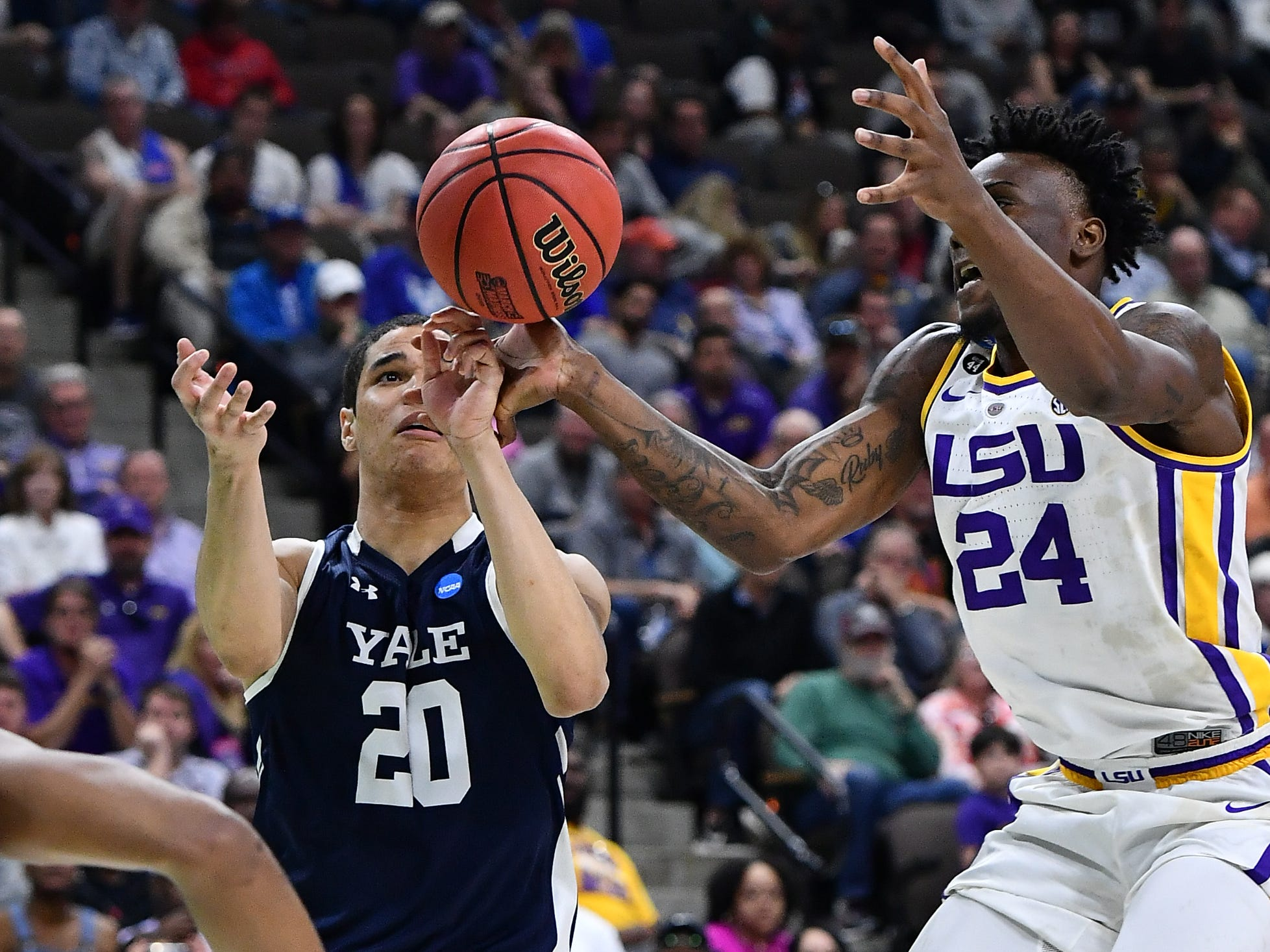 Mar 21, 2019; Jacksonville, FL, USA; Yale Bulldogs forward Paul Atkinson (20) and LSU Tigers forward Emmitt Williams (24) battle for a rebound during the second half in the first round of the 2019 NCAA Tournament at Jacksonville Veterans Memorial Arena. Mandatory Credit: John David Mercer-USA TODAY Sports