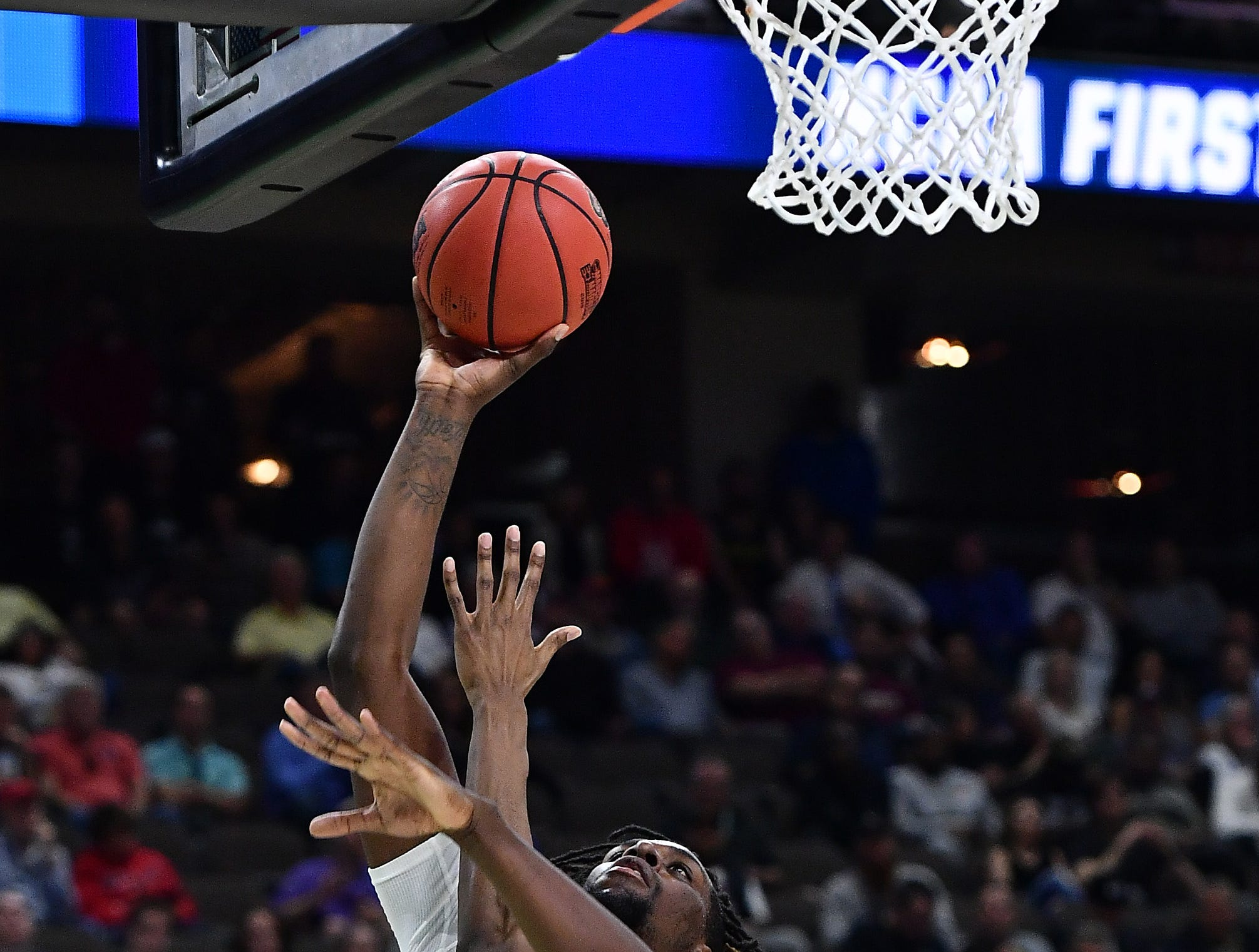 Mar 21, 2019; Jacksonville, FL, USA; LSU Tigers forward Naz Reid (0) shoots over Yale Bulldogs forward Jordan Bruner (23) during the second half in the first round of the 2019 NCAA Tournament at Jacksonville Veterans Memorial Arena. Mandatory Credit: John David Mercer-USA TODAY Sports