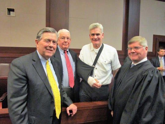 Frank Neuner, David Cassidy and U.S. Sen. Bill Cassidy congratulate Robert Summerhays on his investiture as U.S. District Judge for the Western District of Louisiana.