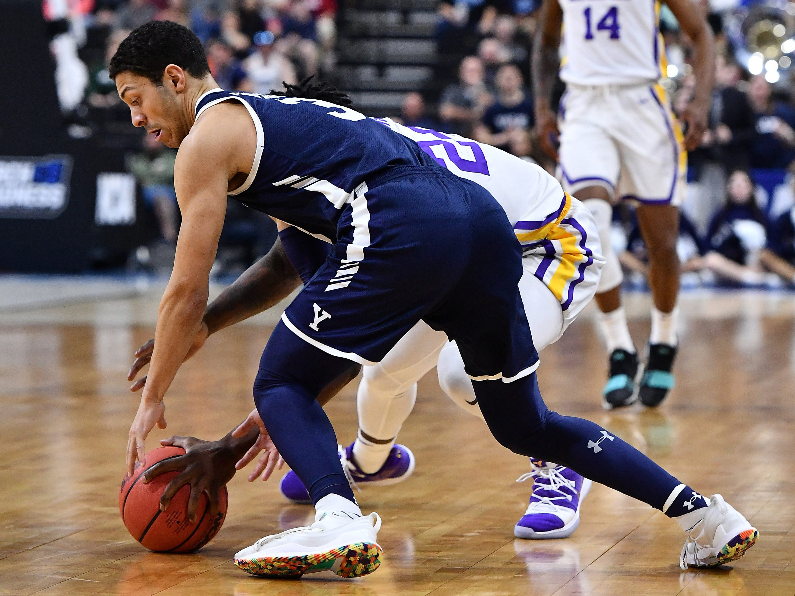Mar 21, 2019; Jacksonville, FL, USA; Yale Bulldogs guard Alex Copeland (3) battles LSU Tigers forward Emmitt Williams (24) for a loose ball during the second half in the first round of the 2019 NCAA Tournament at Jacksonville Veterans Memorial Arena. Mandatory Credit: John David Mercer-USA TODAY Sports