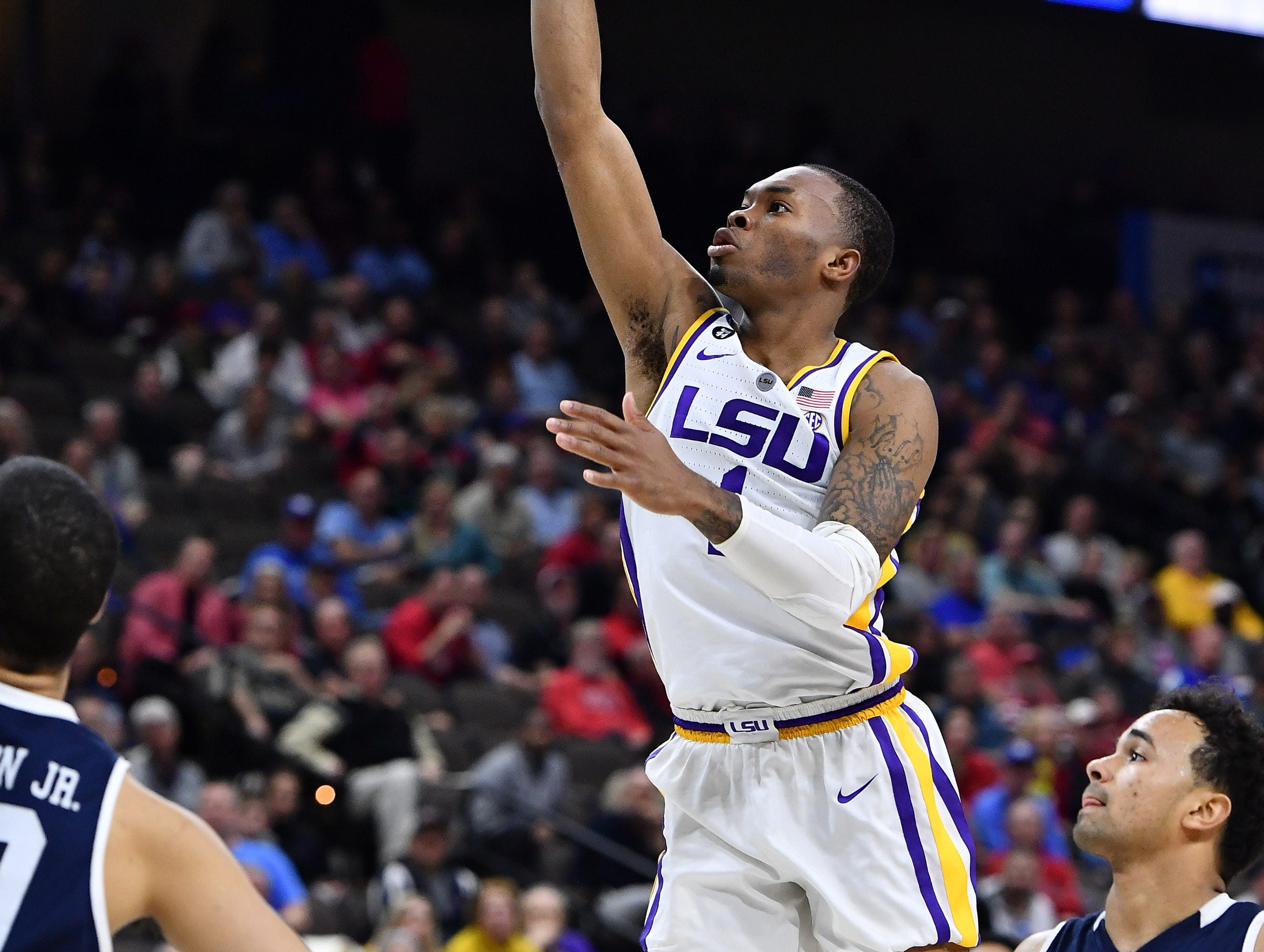 Mar 21, 2019; Jacksonville, FL, USA; LSU Tigers guard Javonte Smart (1) shoots against Yale Bulldogs guard Azar Swain (5) during the second half in the first round of the 2019 NCAA Tournament at Jacksonville Veterans Memorial Arena. Mandatory Credit: John David Mercer-USA TODAY Sports