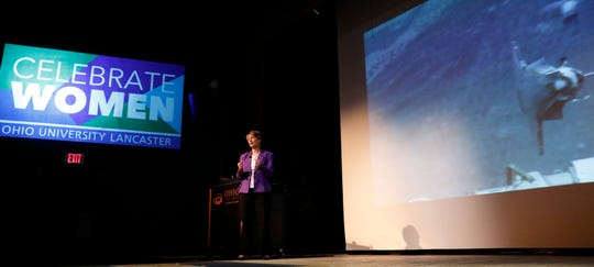 Eileen Collins, the first woman to pilot and command a U.S. space craft, speaks at Ohio University Lancaster's Celebrate Women conference as a video of the space shuttle mission she commanded plays. Collins, a retired Air Force Colonel and retired NASA astronaut, delivered the key note address at the annual conference Friday afternoon, March 22, 2019, in Lancaster.