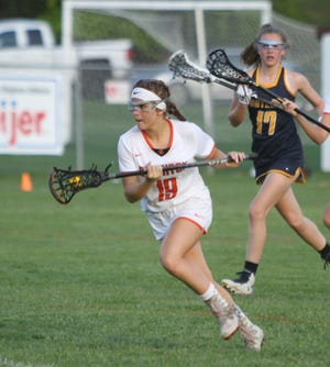 Cat Kopchia had a goal and three assists for Brighton in its season-opening lacrosse victory over Bloomfield Hills.