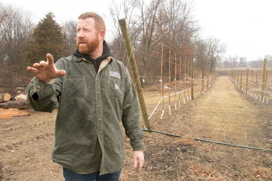 Chris Schell talks about plans for expanding the already planted fruit trees on Schell Family Farm, shown Wednesday, March 20, 2019.