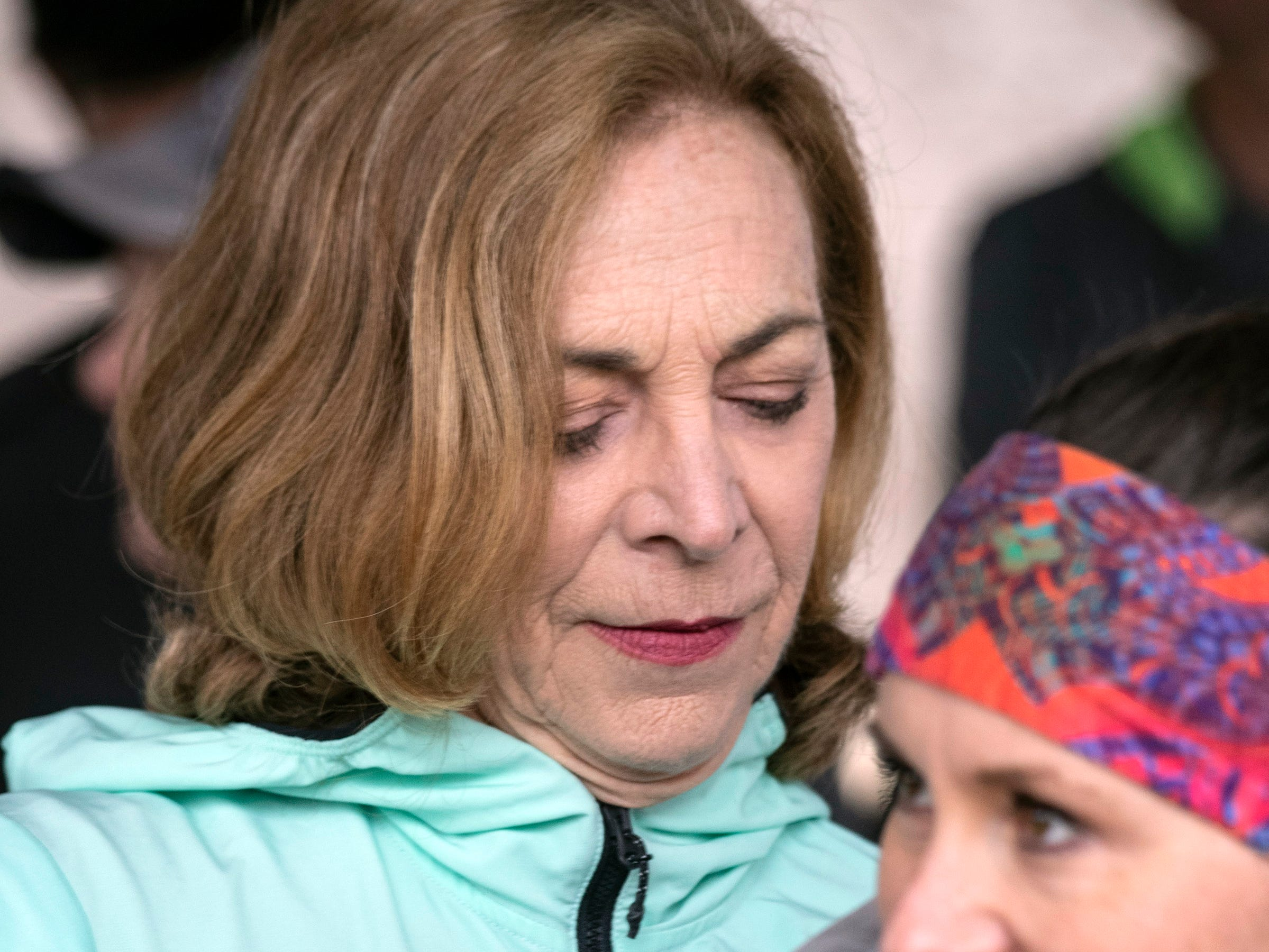 Harmony Ray got an autograph from, and photo with, Boston Marathon legend Kathrine Switzer during a meet and greet and run in Cherokee Park on Thursday.