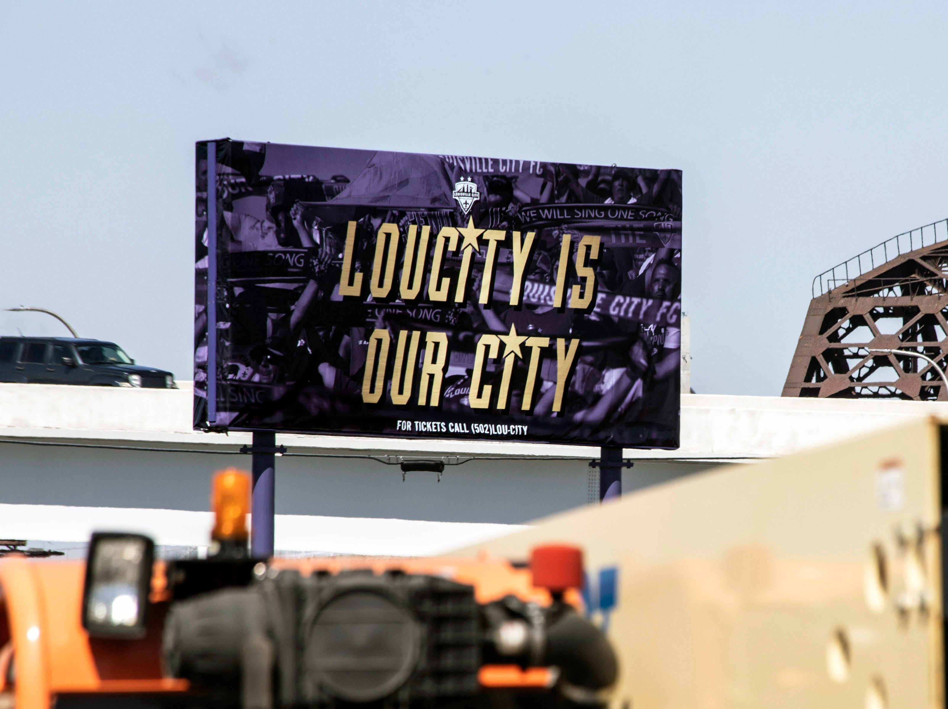 A billboard for Louisville City FC sits on the stadium construction site in Butchertown alongside I-71. 3/22/19