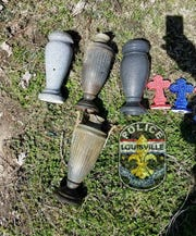 Louisville Metro Police recovered various items, including vases and crosses, which they say were stolen from grave sites at St. Stephens Cemetery.
