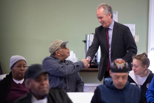 Louisville Mayor Greg Fischer meets with volunteers at a senior nutrition center on Friday, letting attendees know that 15 Metro Council members voted against his revenue plan, and will be responsible for upcoming cuts to city services.