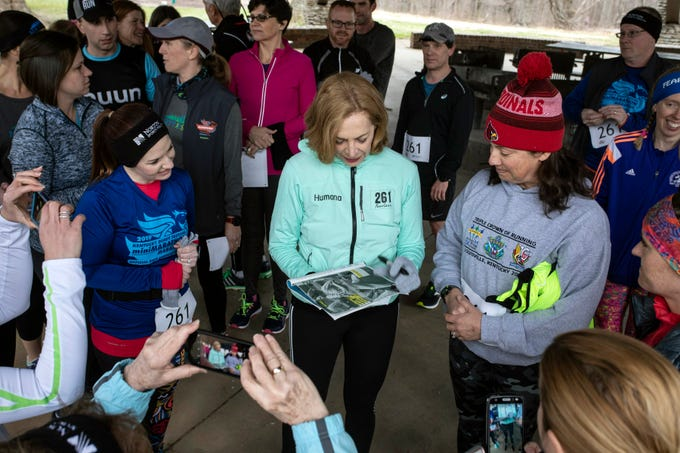 Kathrine Switzer signed photos and books for some of her fans near Hogan's Fountain in Cherokee Park on Thursday afternoon. Switzer became the first woman to run the Boston Marathon as a numbered entrant in 1967.
