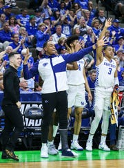 Kentucky's PJ Washington Jr cheered for his team from the sidelines as the Wildcats blew out Abilene Christian 79-44 in the NCAA first round in Jacksonville Thursday. March 21, 2019