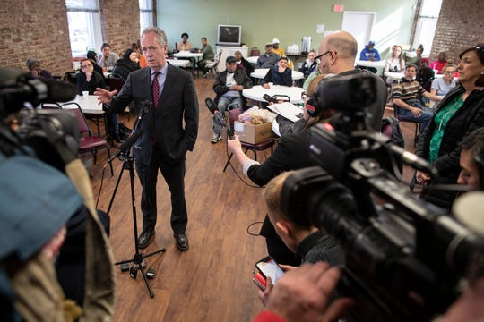 Mayor Greg Fischer speaks to media Friday about the Metro Council vote.