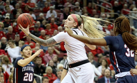 Louisville's Sam Fuehring drives past two Robert Morris defenders to make two of her 19 points on March 22 in the KFC Yum Center in Louisville.