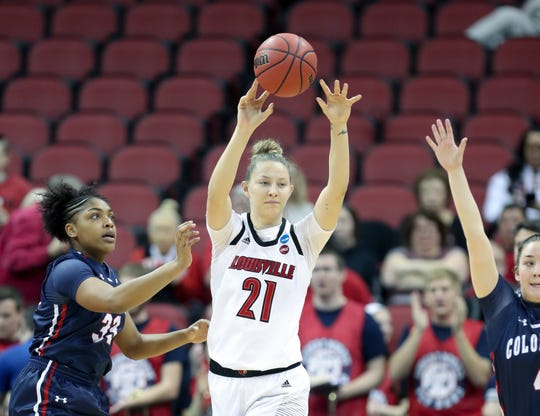 Louisville's Kylee Shook passes out of pressure during their game against Robert Morris on March 22 in the KFC Yum Center in Louisville.