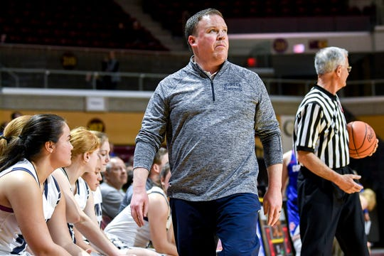 Fowler's head coach Nathan Goerge looks on during the second quarter on Thursday, March 21, 2019, at the Van Noord Arena on the Calvin College campus in Grand Rapids.