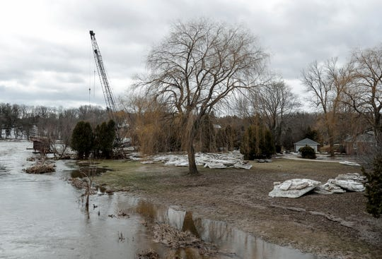 Ice sheets sit in a backyard near Rapids Road after flood waters recede on the Manitowoc River Friday, March 22, 2019, in Manitowoc, Wis. Joshua Clark/USA TODAY NETWORK-Wisconsin