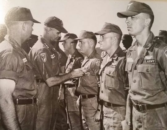 Linscott, pictured far right,receive multiple medals during his time in the service, including the Purple Heart.