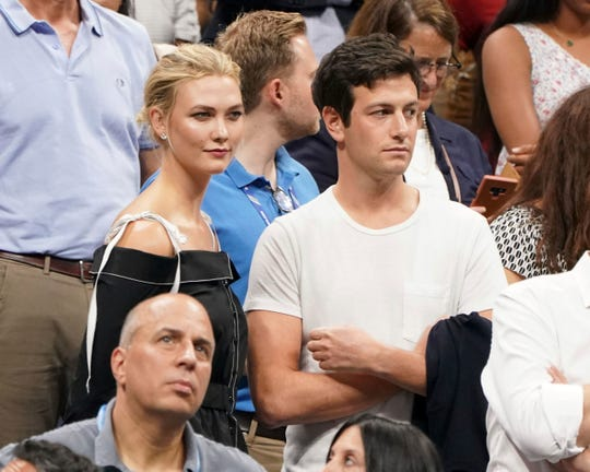 In this Sept. 6, 2018 file photo, Karlie Kloss, top left, and Joshua Kushner attend the semifinals of the U.S. Open tennis tournament at the USTA Billie Jean King National Tennis Center in New York.