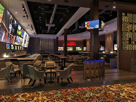 Rendering of interior of sports bar with sports wager facility proposed by Gold Strike Casino in Robinsonville, Miss.