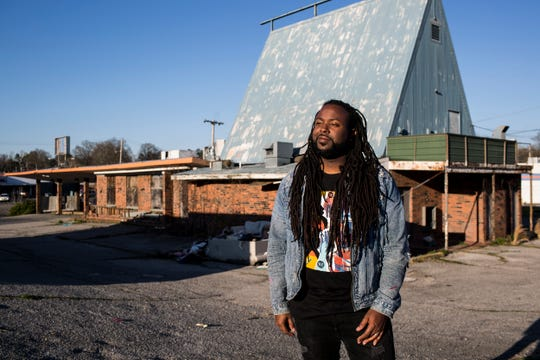 """March 21, 2019 - Jamond Bullock, a Memphis muralist, is working with the city's UrbanArt Commission to transform the blighted space where the abandoned Whataburger sits on Frayser Boulevard. """"This project is centered around dumping, and my way of combating the dumping is to transform the space,"""" Bullock said."""