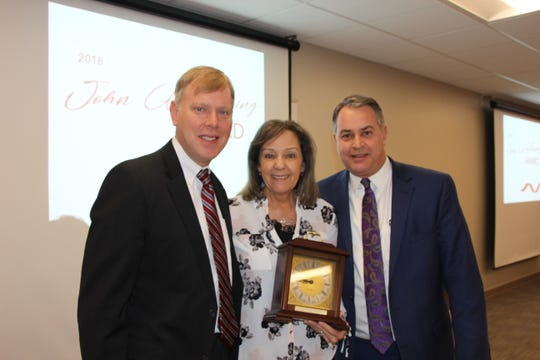 Shorewest Realtors recognizes the good work of employees. Linda Kraayeveld is joined by John P. Horning (left) and Joe Horning as she receives the John A. Horning Award at Shorewest's Support Center Awards. She was nominated by her peers as someone who has gone above and beyond in her job.