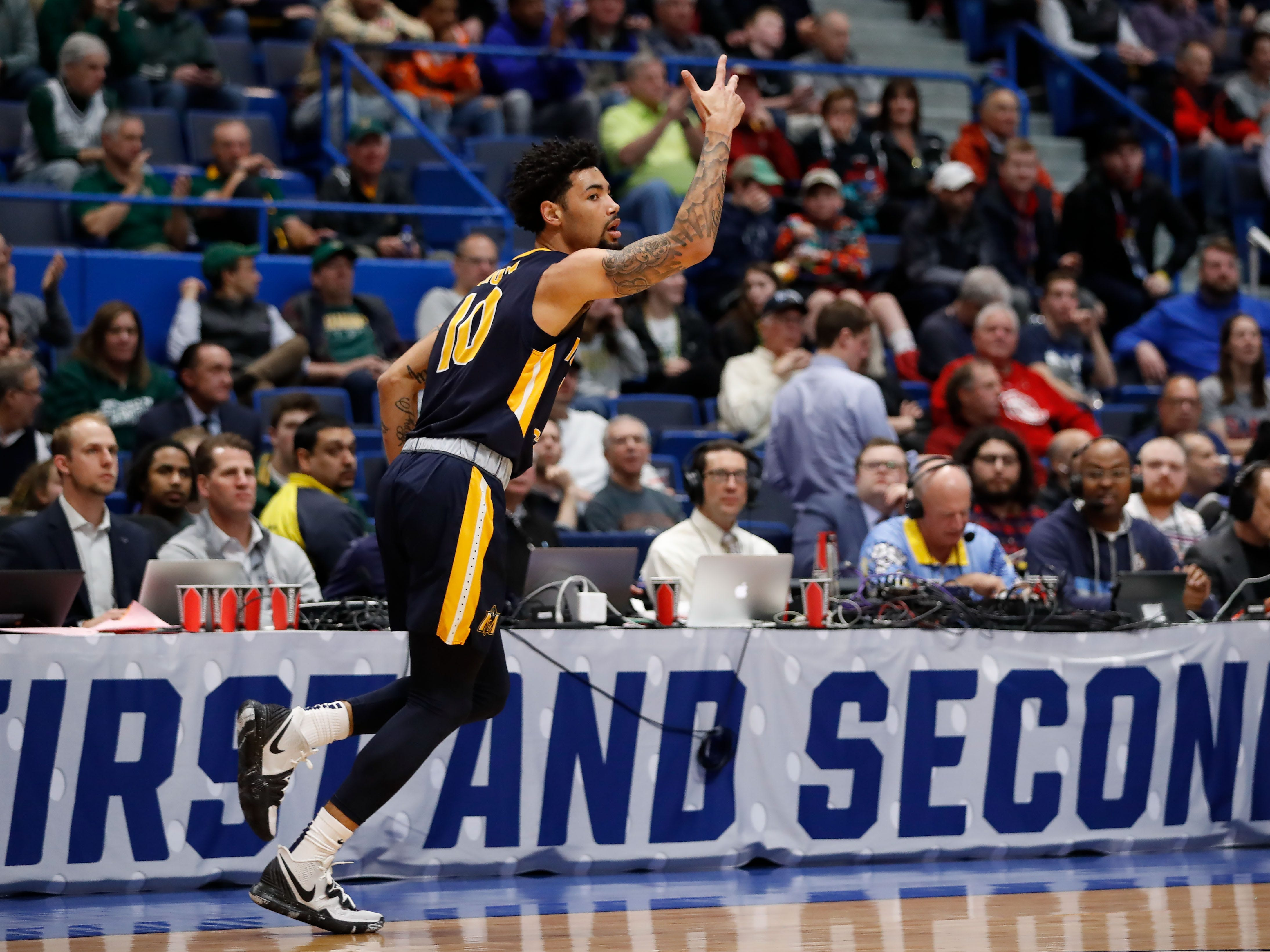 Murray State guard Tevin Brown heads down the court after draining a three-pointer against Marquette during the first half.