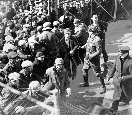 A crowd of several hundred milk strike pickets are shown in 1933 crashing the gate of the Electric Co. freight yard in Waukesha with the intention of dumping a trainload of milk headed to Milwaukee. Officials called in the Waukesha Fire Department to control the crowd with water hoses.