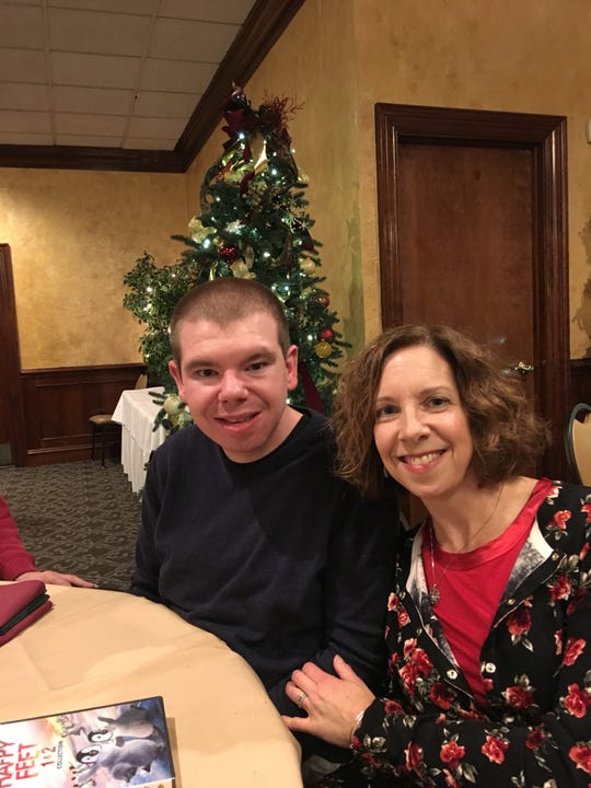 Karen Franco and her son, Jacob, attend the Christmas party at Crabtree Residential, where Jacob lives.