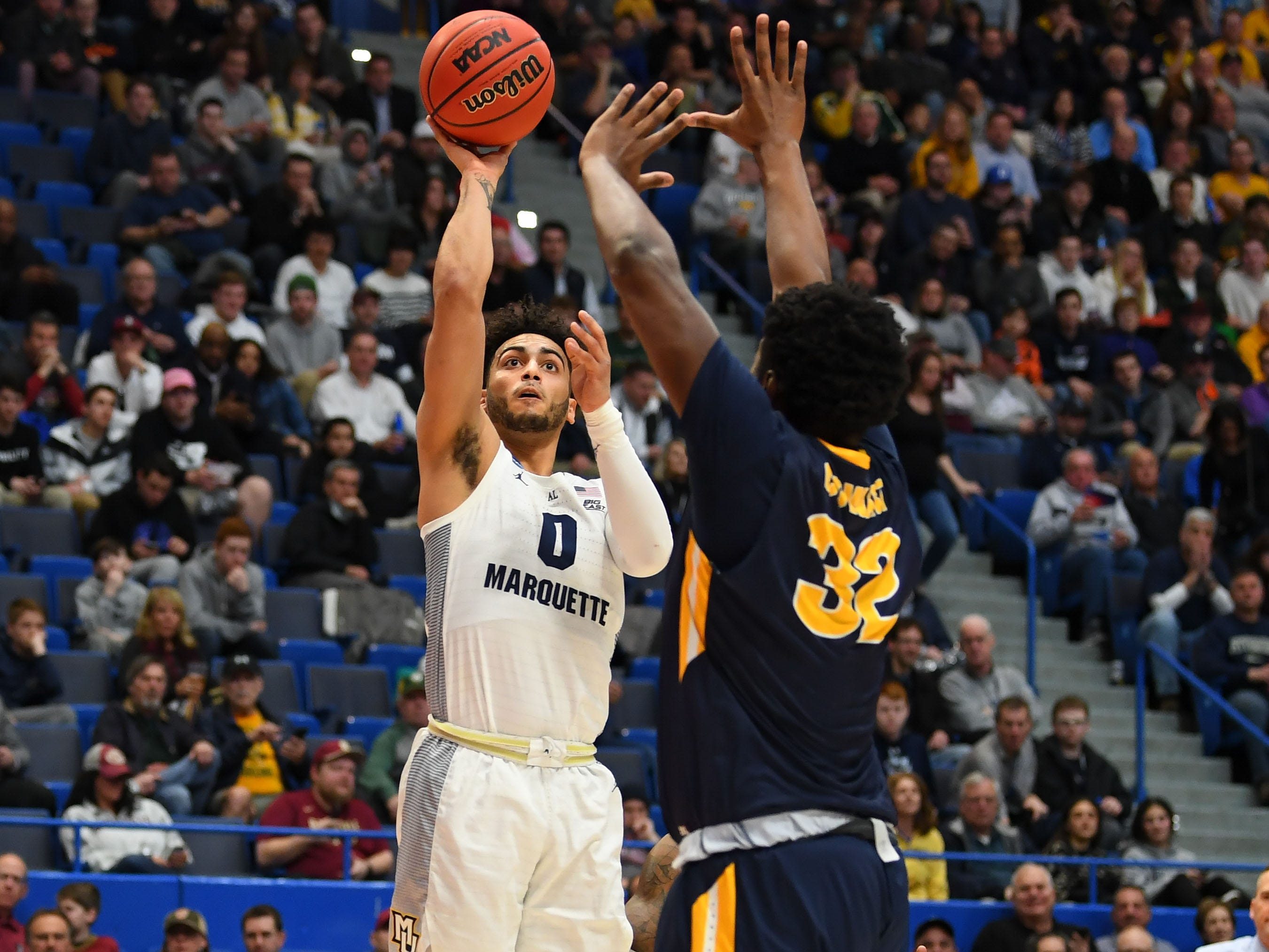 Golden Eagles guard Markus Howard lifts a shot over Murray State's Darnell Cowart during the first half.