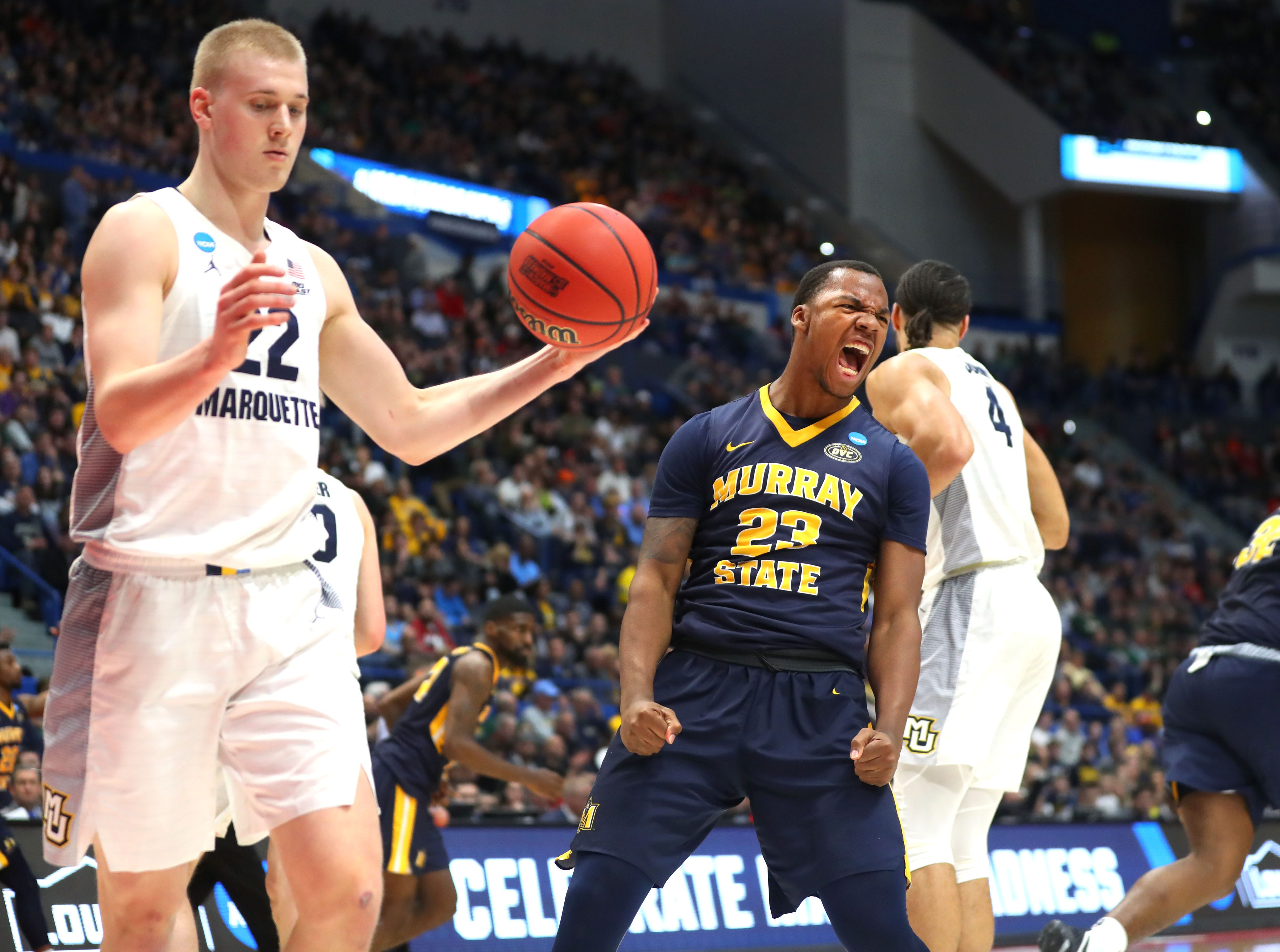 KJ Williams of Murray State is pumped up after slamming home two points against Marquette.