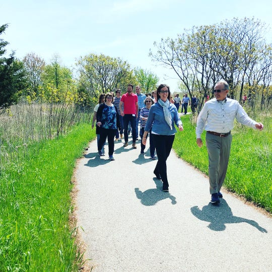 Employees of West Bend Mutual Insurance participate in an organized walk known as the Steiner Stomp, which is led by CEO Kevin Steiner.