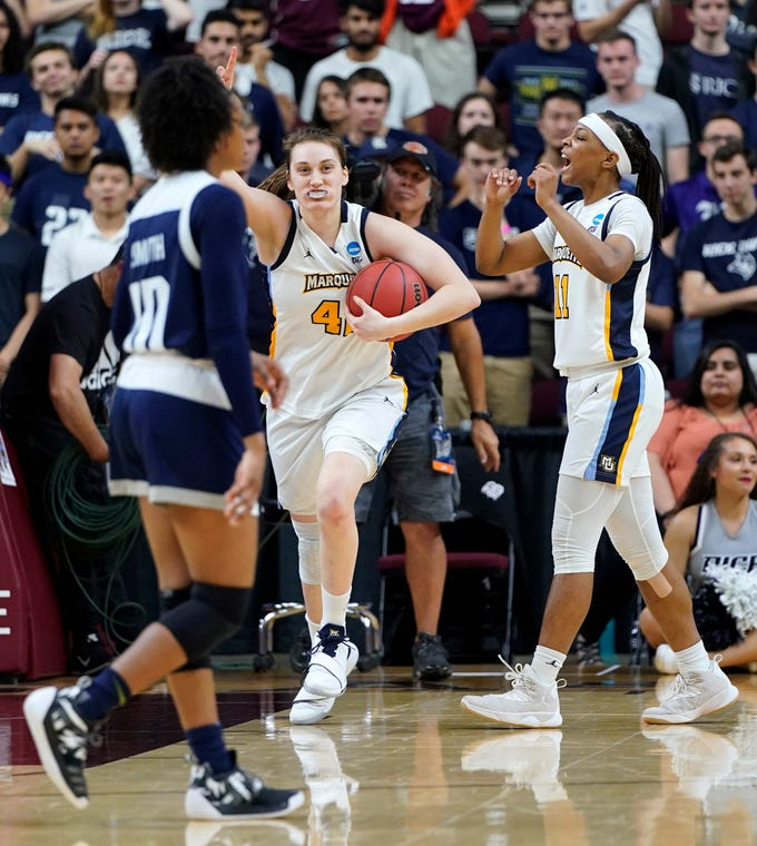 Marquette's Lauren Van Kleunen, (center) and Allazia Blockton celebrate as Rice's Jasmine Smith walks off the court after the Golden Eagles' come-from-behind, overtime victory over the Owls in the first round of the NCAA women's basketball tournament in College Station, Texas.