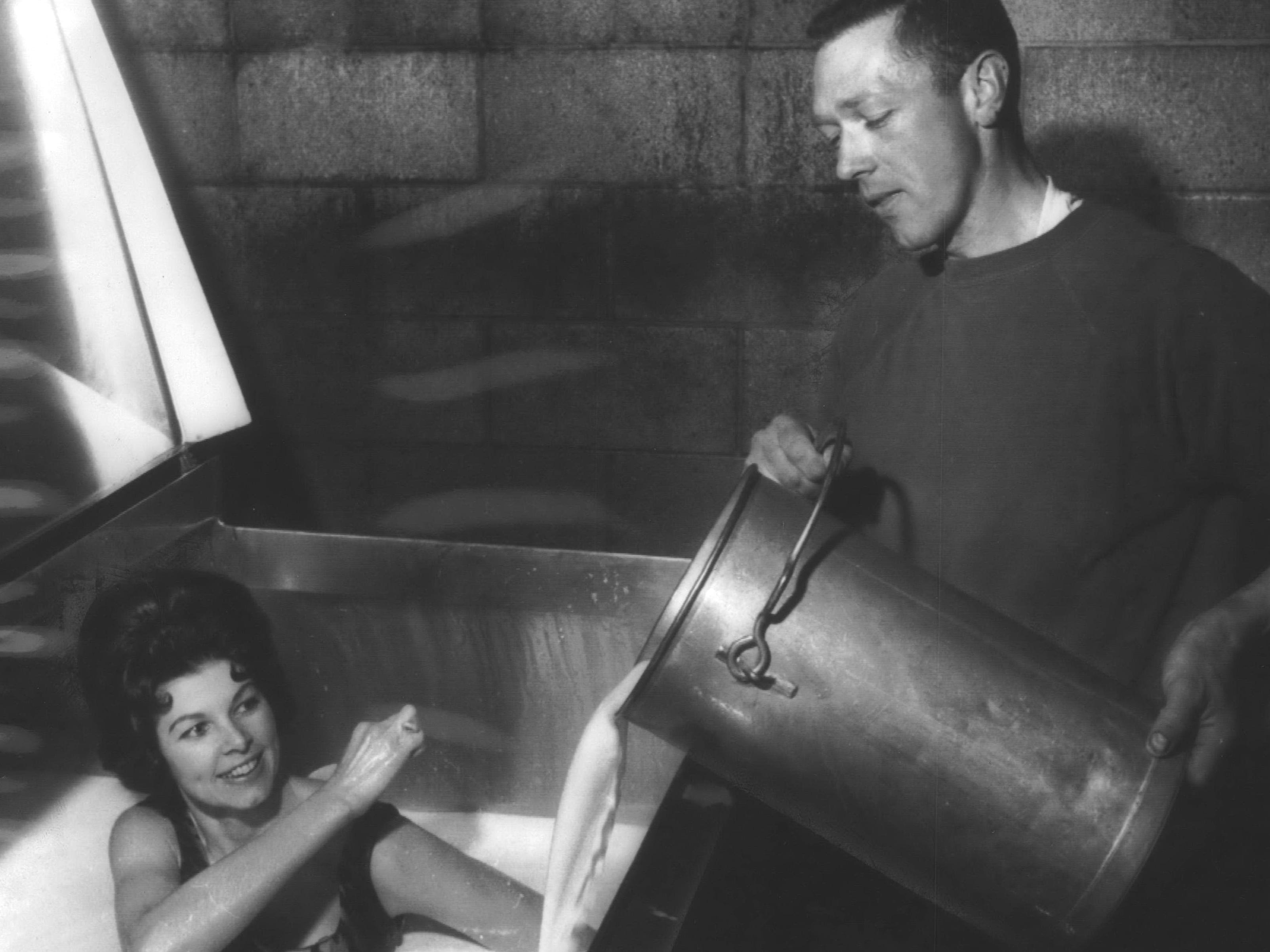 1967: National Farmers Organization members Mr. and Mrs. Dodridge Brooks of Waupaca had plenty of milk to spare because they were participating in the milk strike and holding back their supply in hopes that dairy farmers would receive a better price for their milk. Mrs. Brooks decided to make use of the extra milk by taking a bath in their holding tank. While she scrubbed, her husband poured in more warm milk.