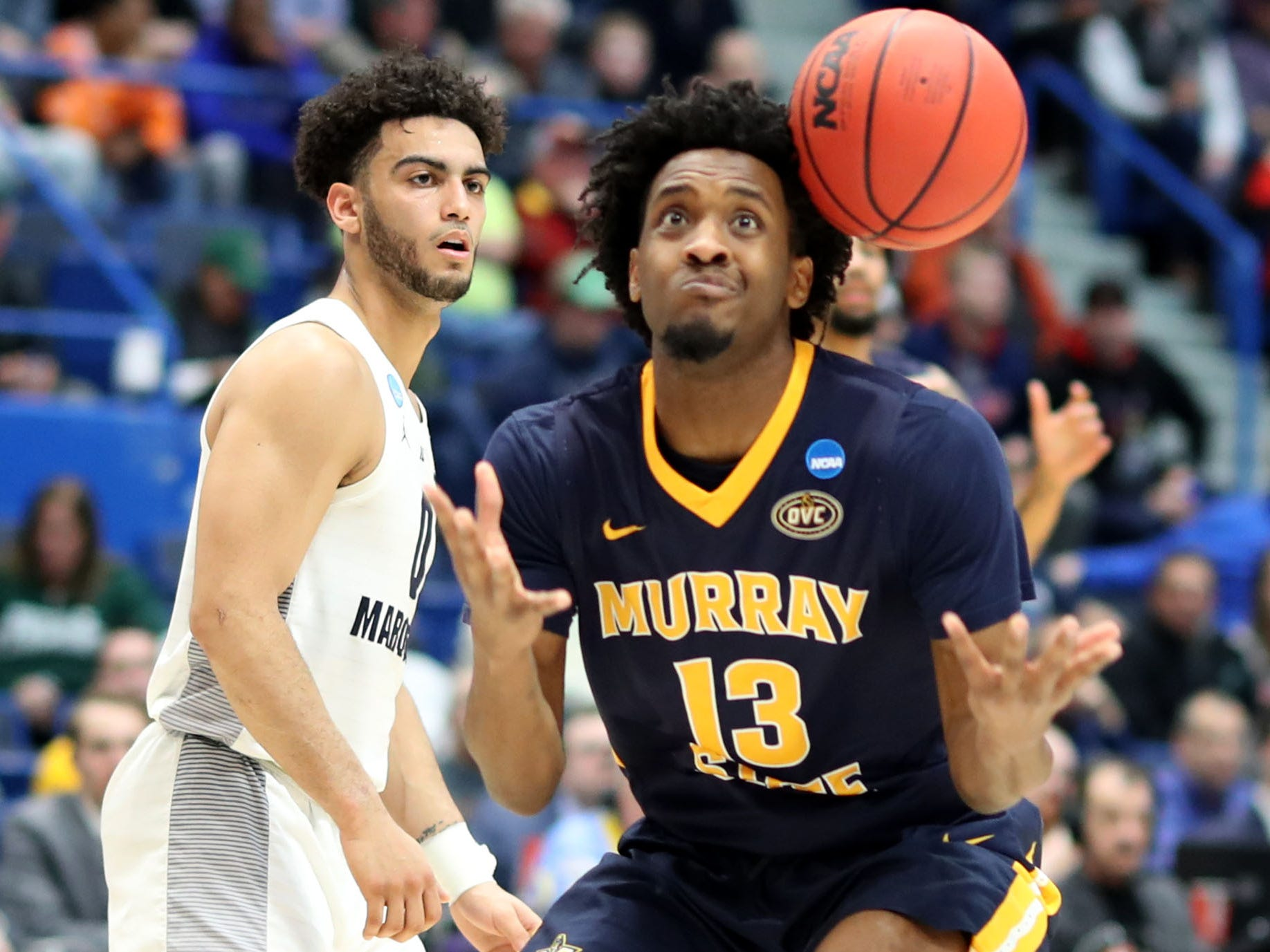 Murray State's Devin Gilmore is unable to gain control of the ball as Marquette guard Markus Howard looks on.