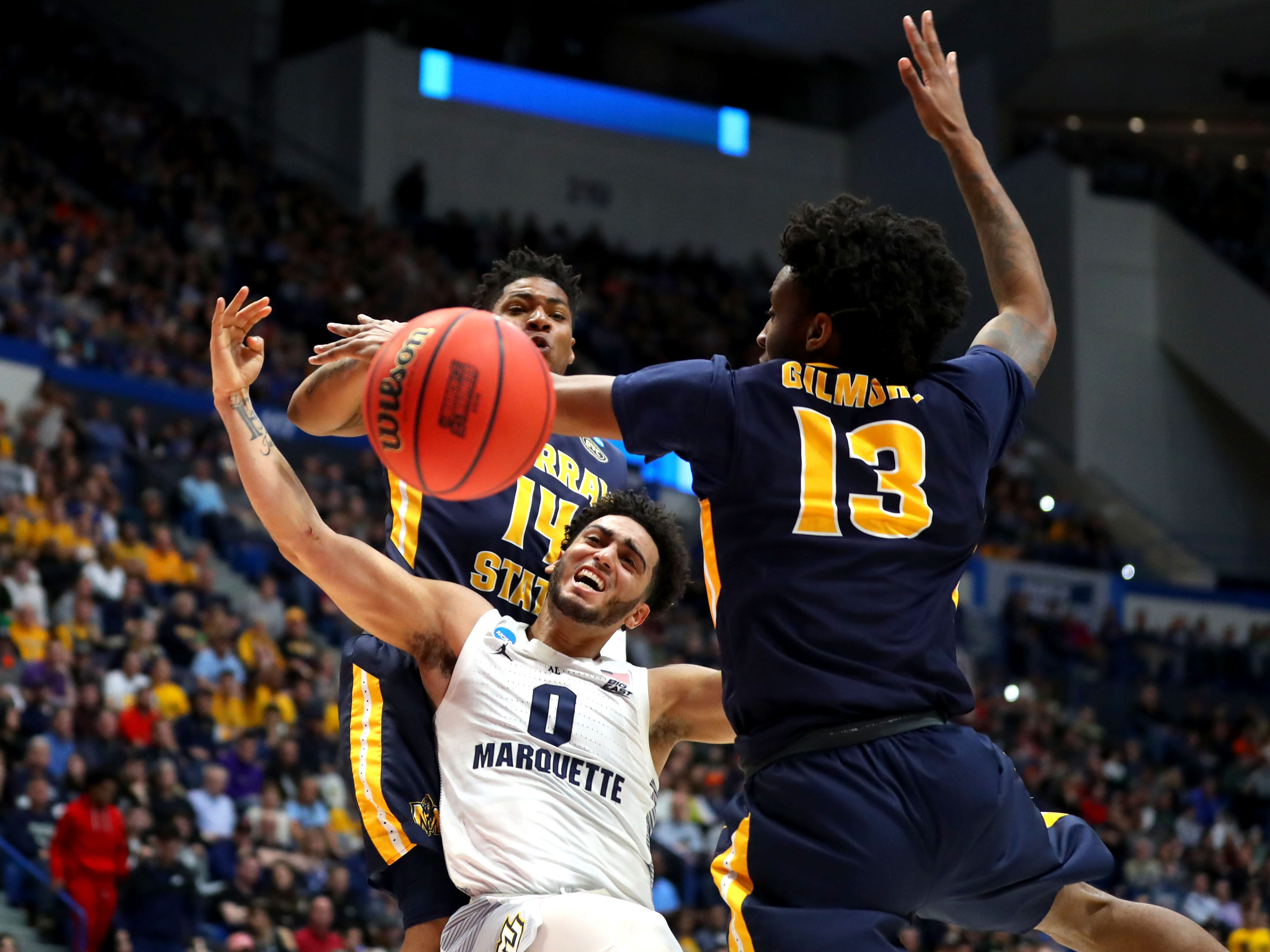 Markus Howard of Marquette is fouled on a drive to the basket against Murray State.