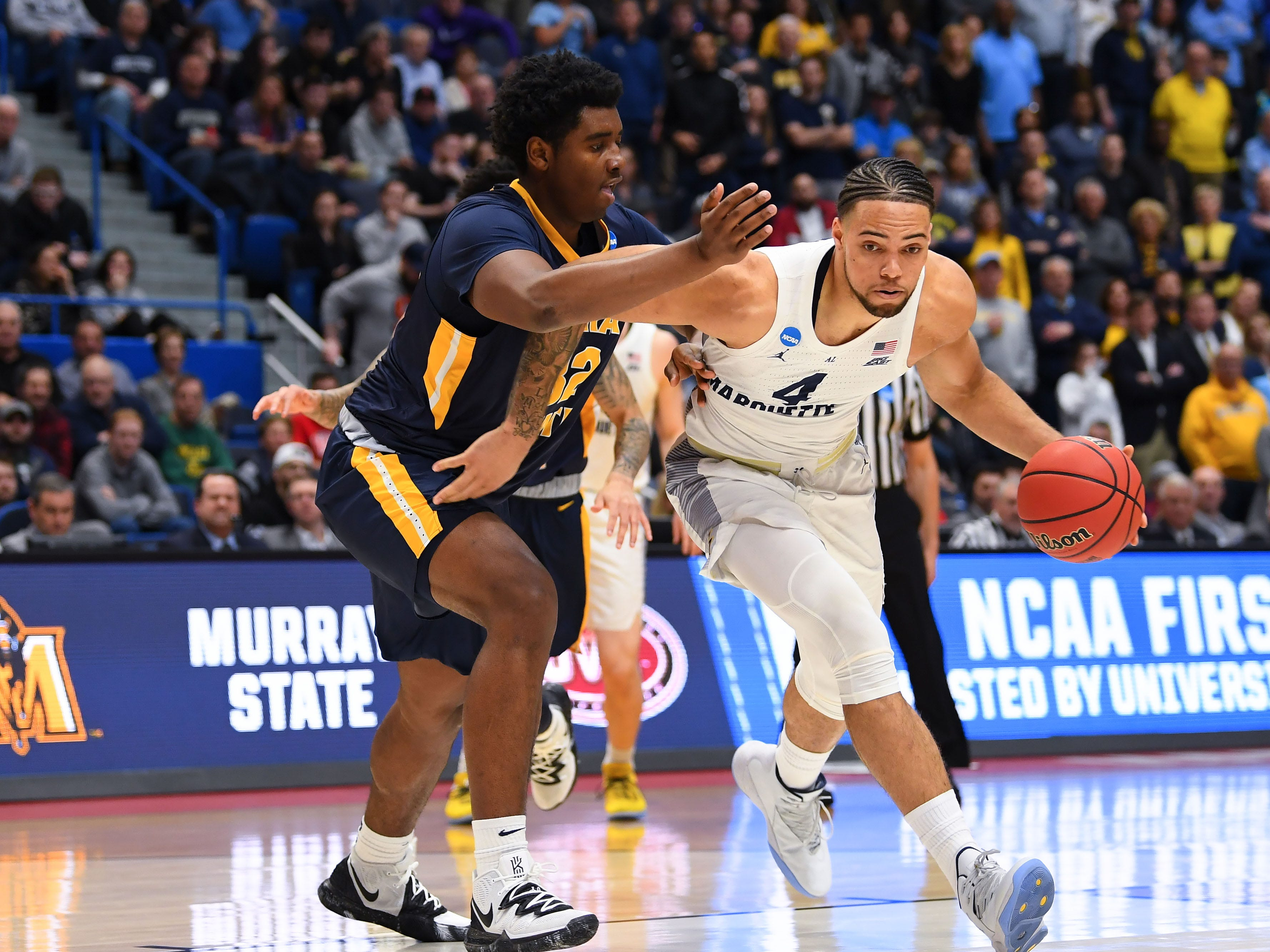 Golden Eagles forward Theo John  drives against Murray State forward Darnell Cowart during the first half.