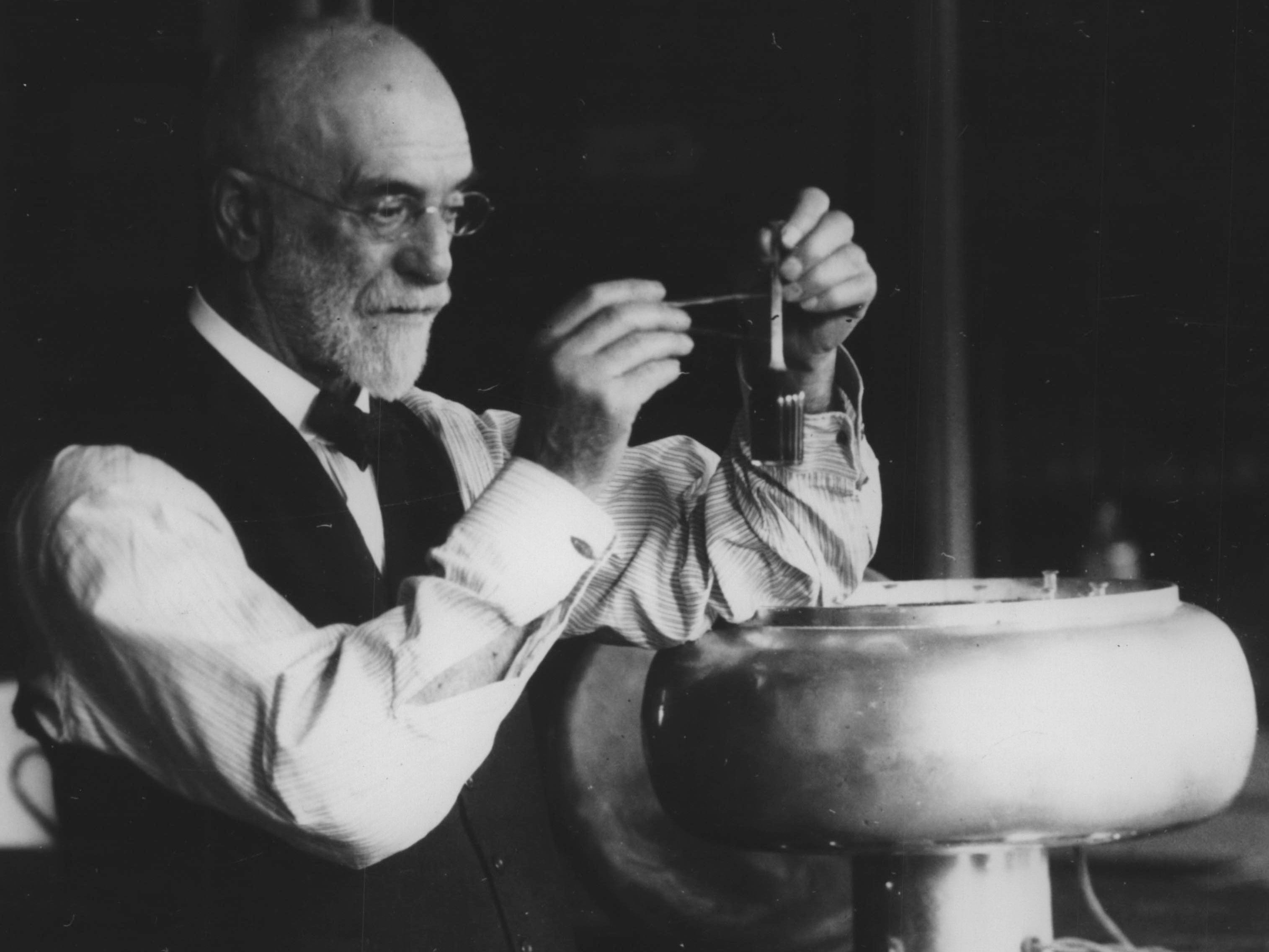 Circa 1926: In 1890, a butterfat tester developed by UW-Madison professor Stephen Babcock gave farmers, creameries and cheesemakers a simple and fast way to determine the quality of milk.   Babcock is shown with his electric  butterfat tester.