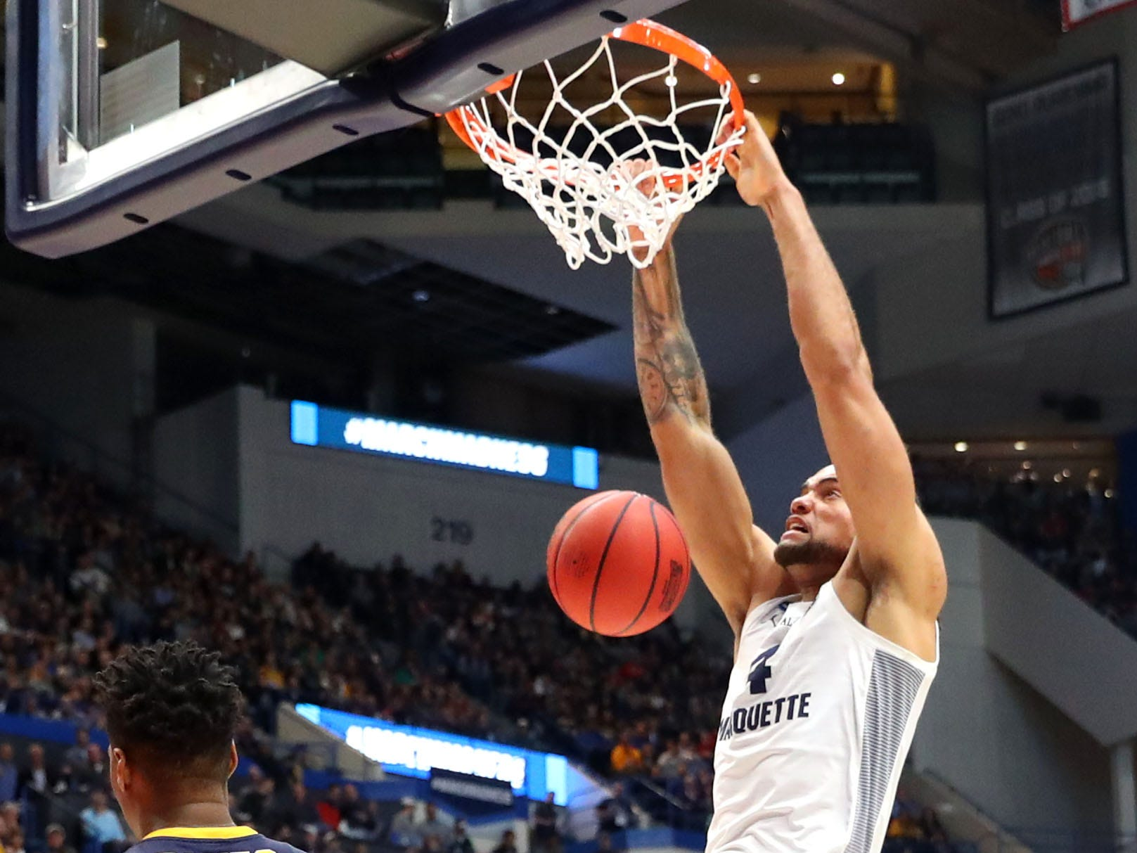 Theo John of the Marquette dunks against Murray State on Thursday.