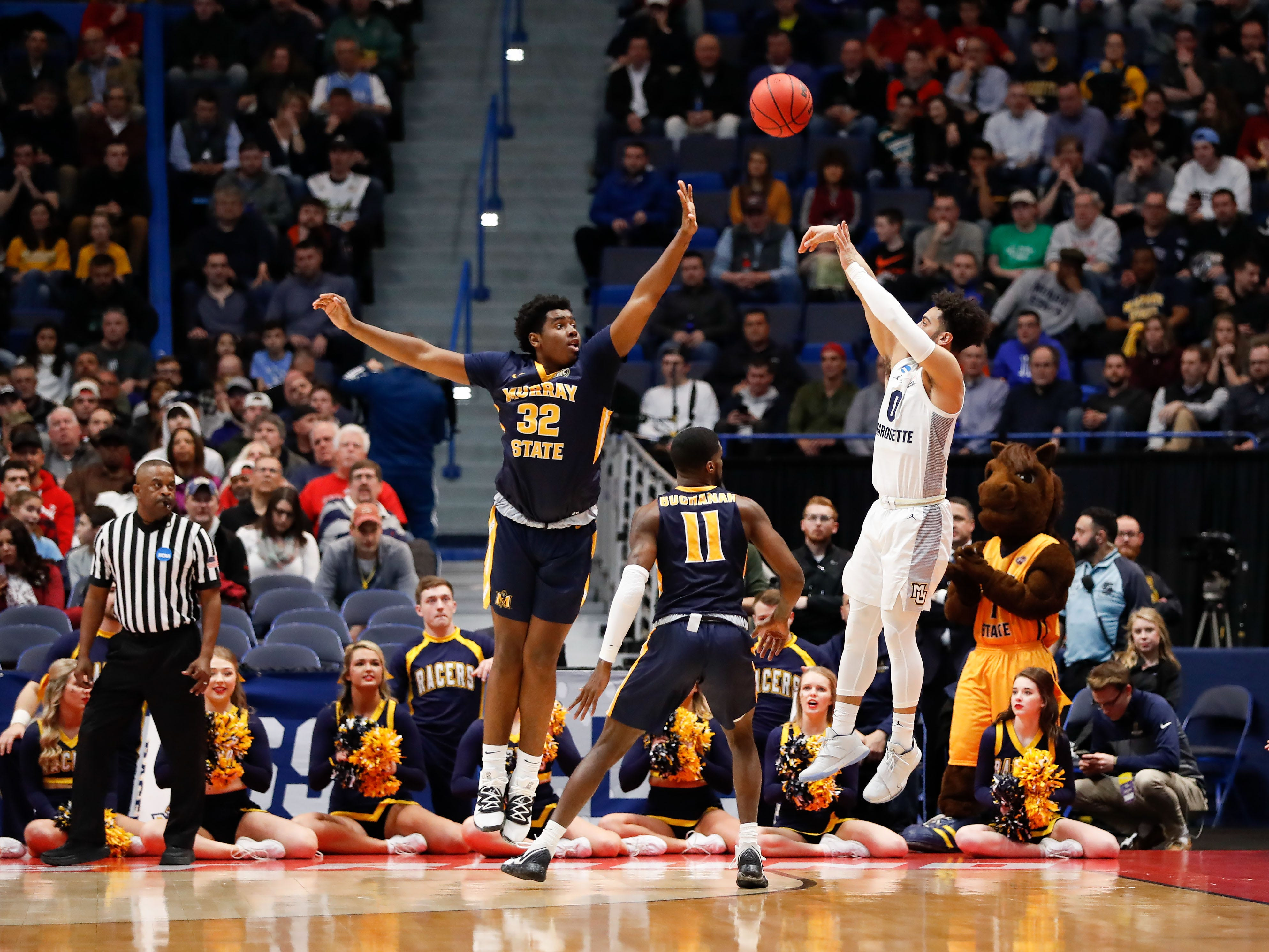 Marquette guard Markus Howard puts up a three-point attempt over Murray State forward Darnell Cowart during the first half.