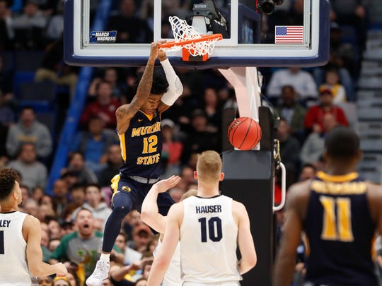 Murray State standout guard Ja Morant dunks on Joey Hauser of Marquette during the second half of their NCAA Tournament first round game on Thursday in Hartford, Conn.