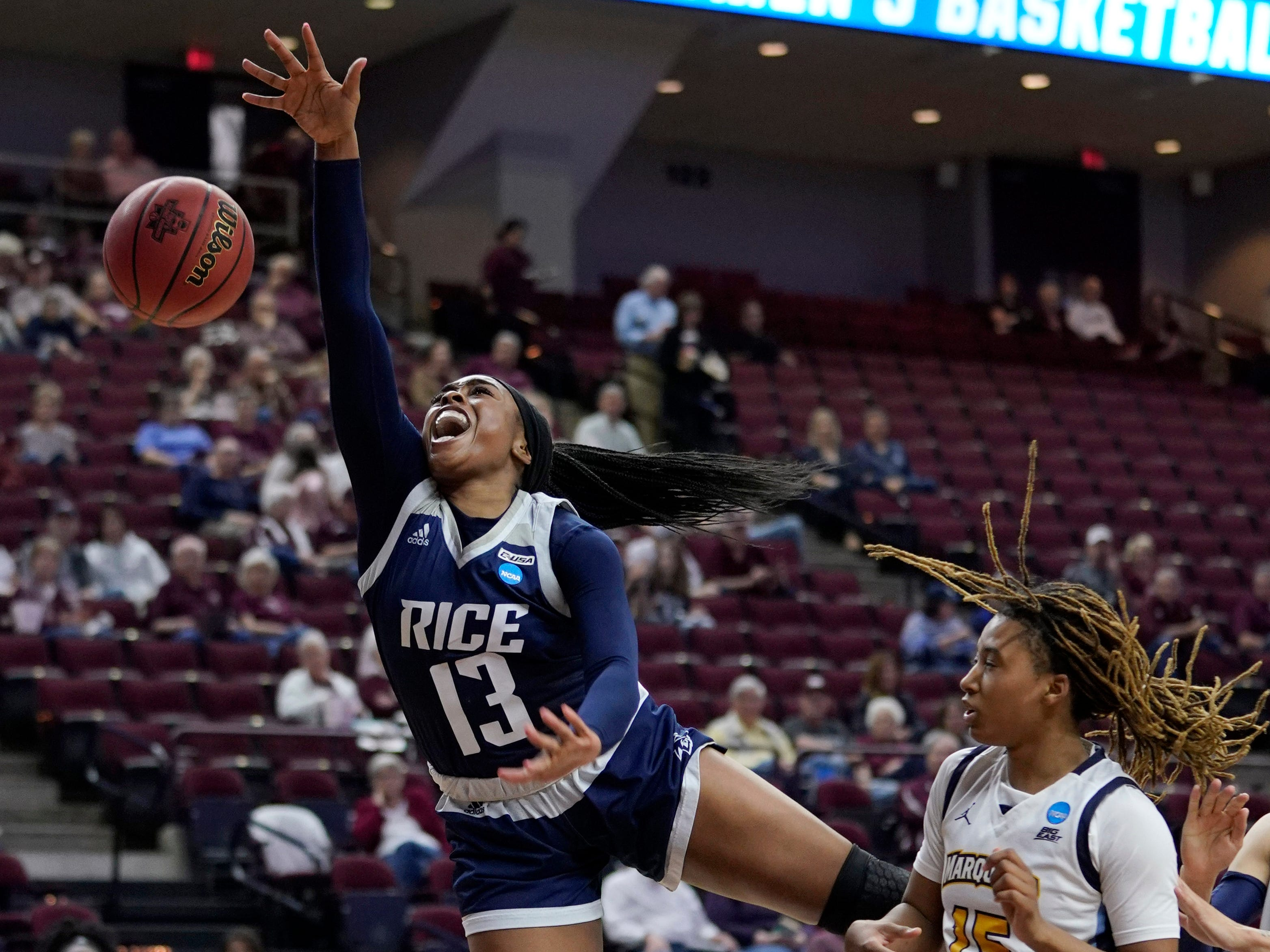Marquette's Amani Wilborn (right) knocks the ball from Rice's Erica Ogwumike during the second half.