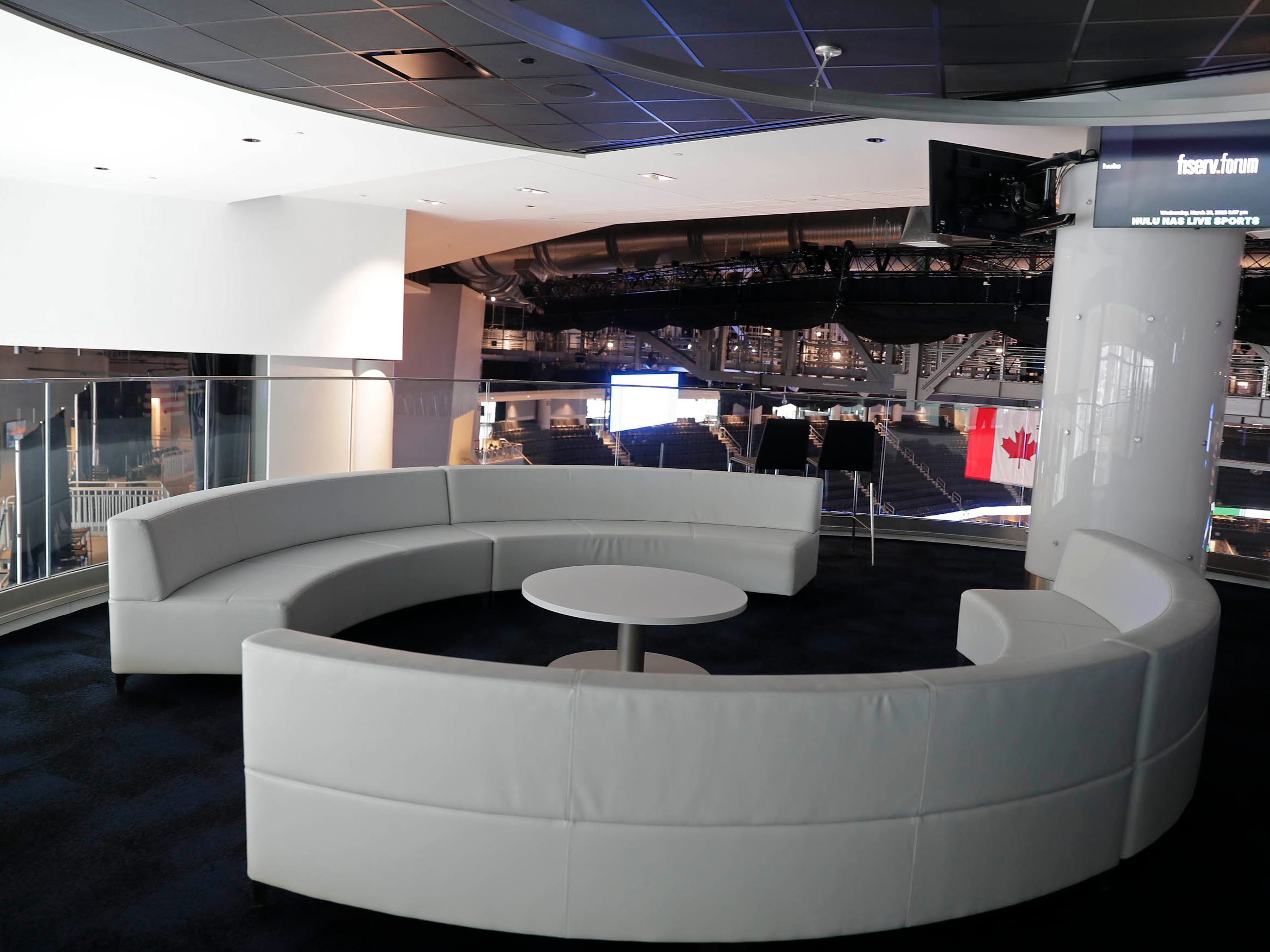 Premium lounges and event space near top of Fiserv Forum have comfortable seating to create an environment for causal interaction.