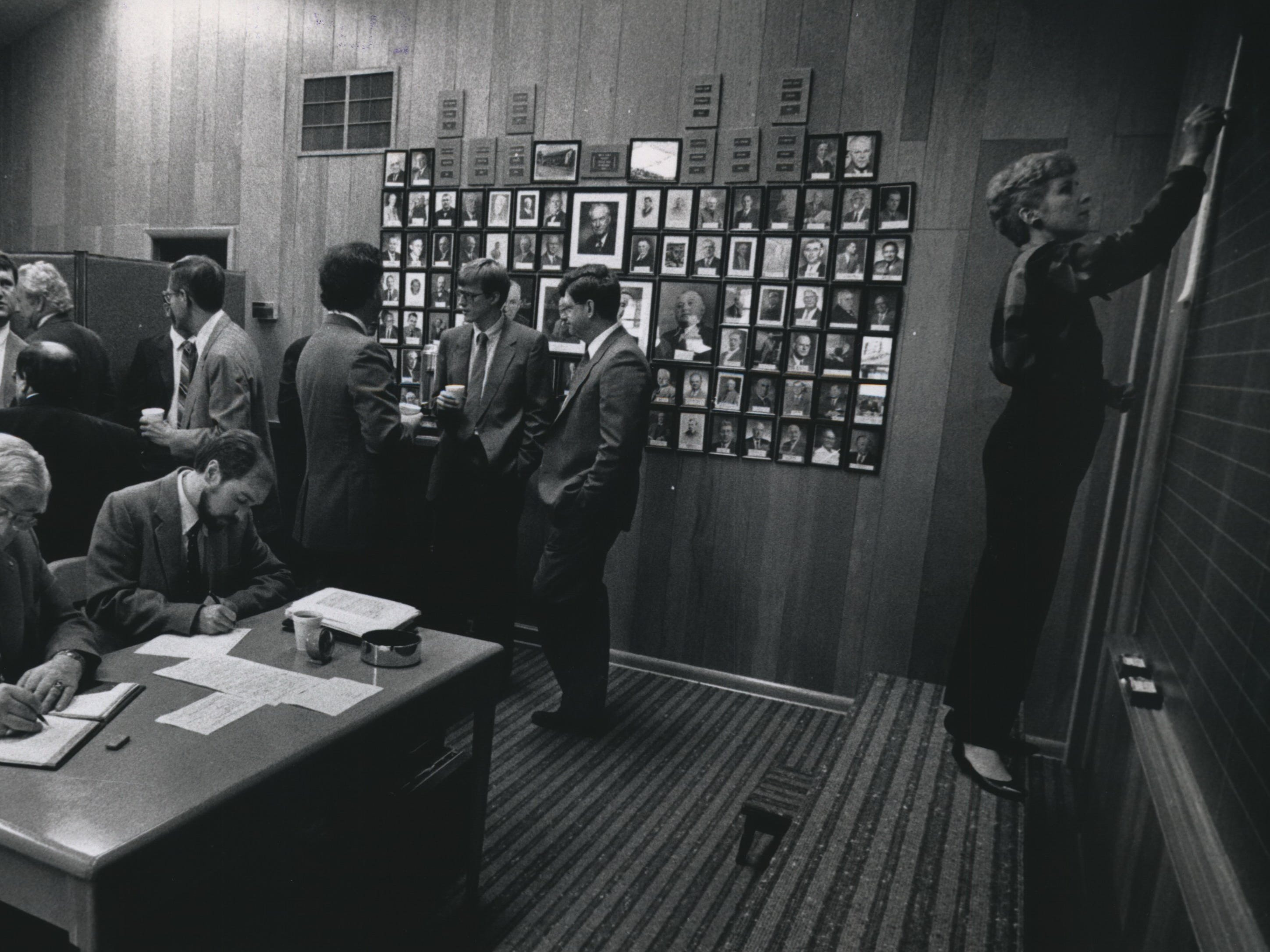 Trading gets underway at the National Cheese Exchange in Green Bay. Every Friday morning, a handful of members met in a room with chalkboards to buy, sell and set the nation's cheese prices. Clerk Tina Seifert writes down the latest prices as the brokers watch for a good price. The National Cheese Exchange operated out of Green Bay from the 1950s until its demise in 1997. Price setting was then computerized and moved to the Chicago Mercantile Exchange.