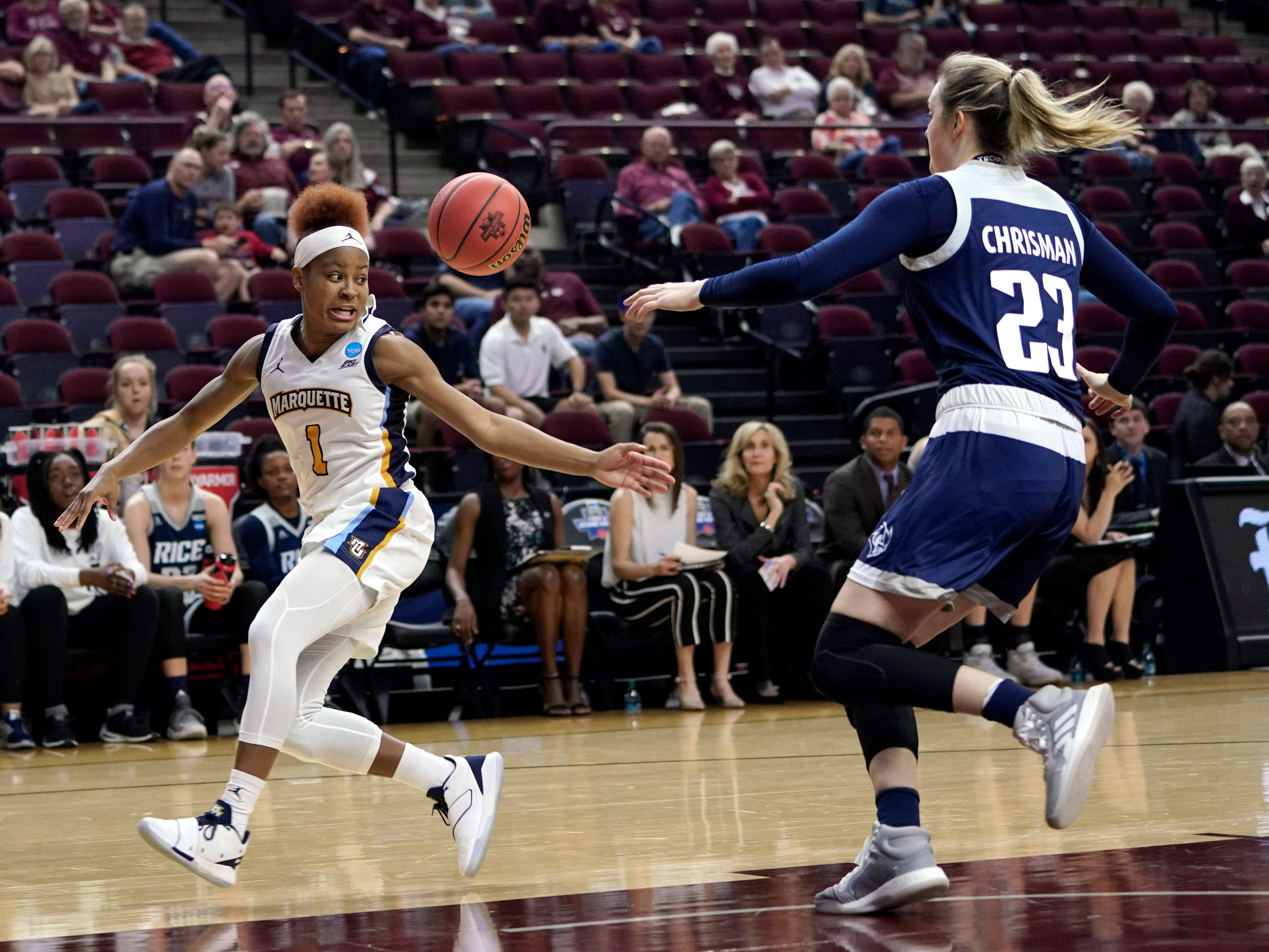 Marquette's Danielle King reaches for a pass as Rice's Alexah Chrisman closes in during the first half.