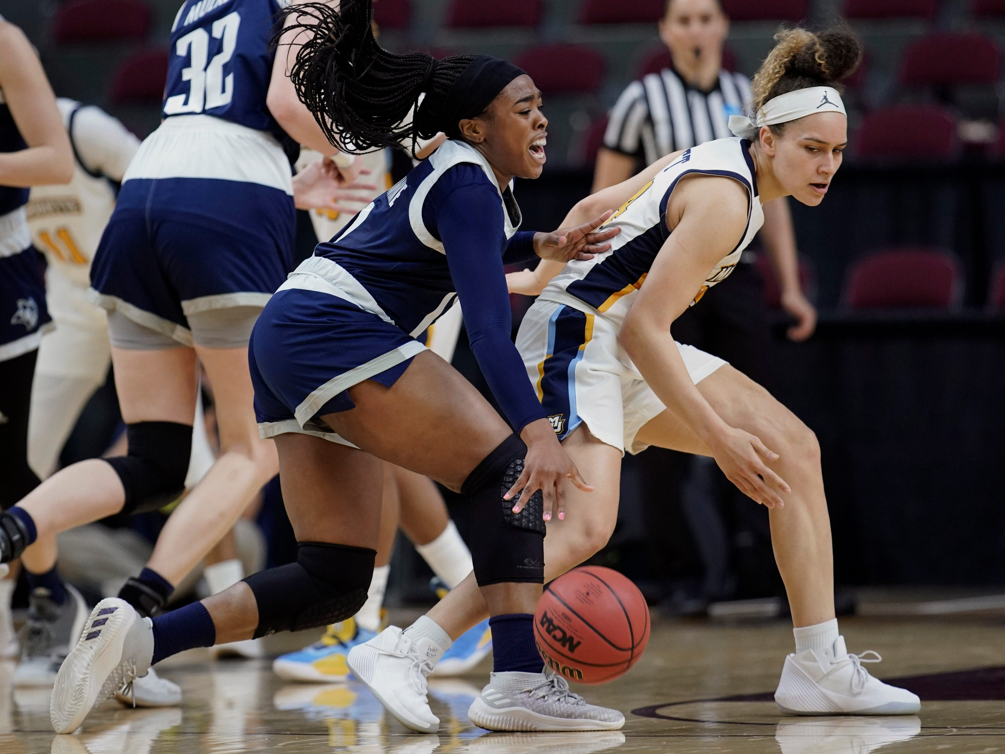 Rice's Erica Ogwumike (left) runs into Marquette's Selena Lott during the first half.