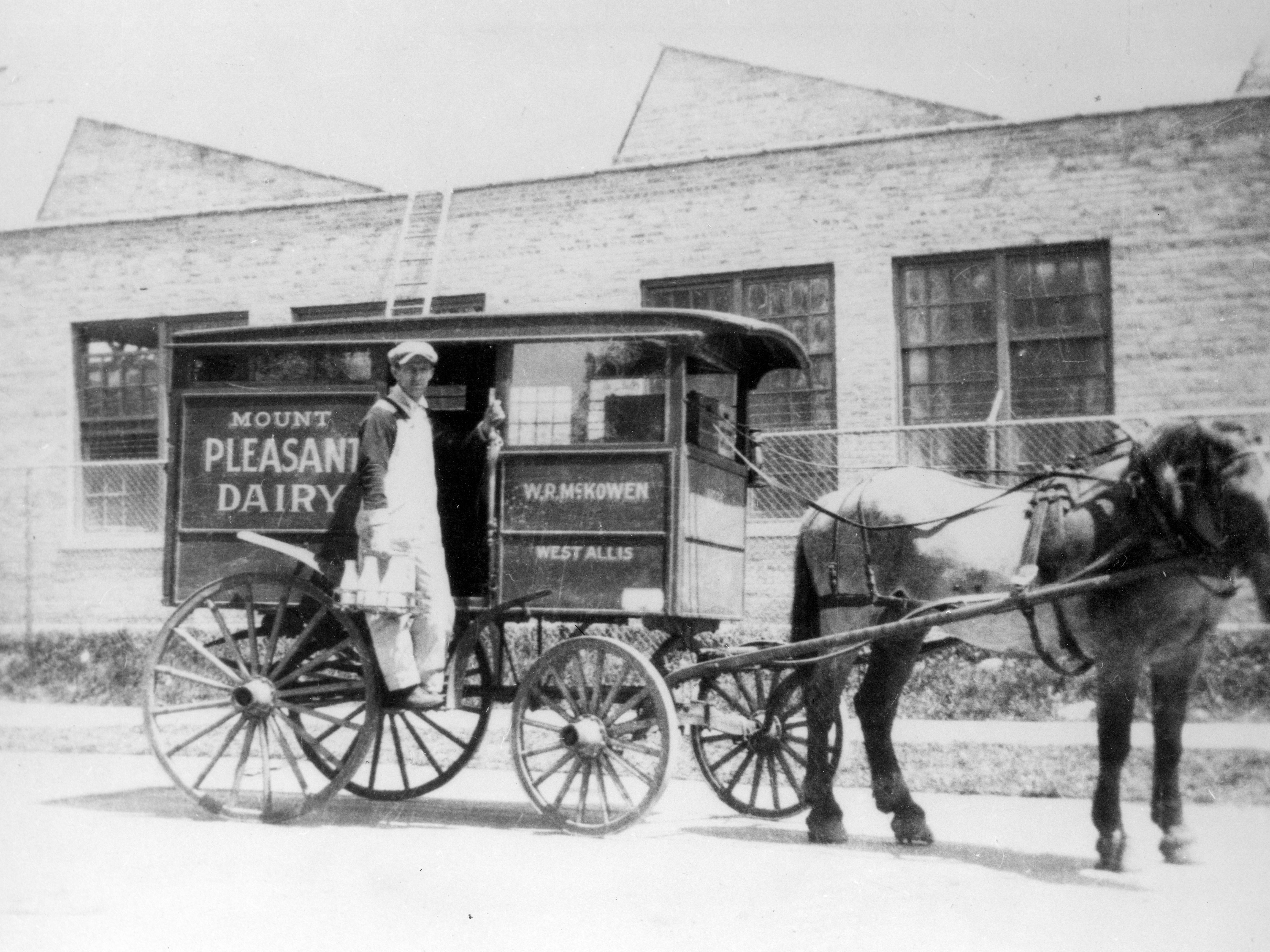 Circa 1919: Milkman Harry Pardun with his covered dairy delivery wagon and horse. The Wm. R. McKowen dairy business was at 67th Street and National Avenue. The dairy existed between 1913 and 1925.
