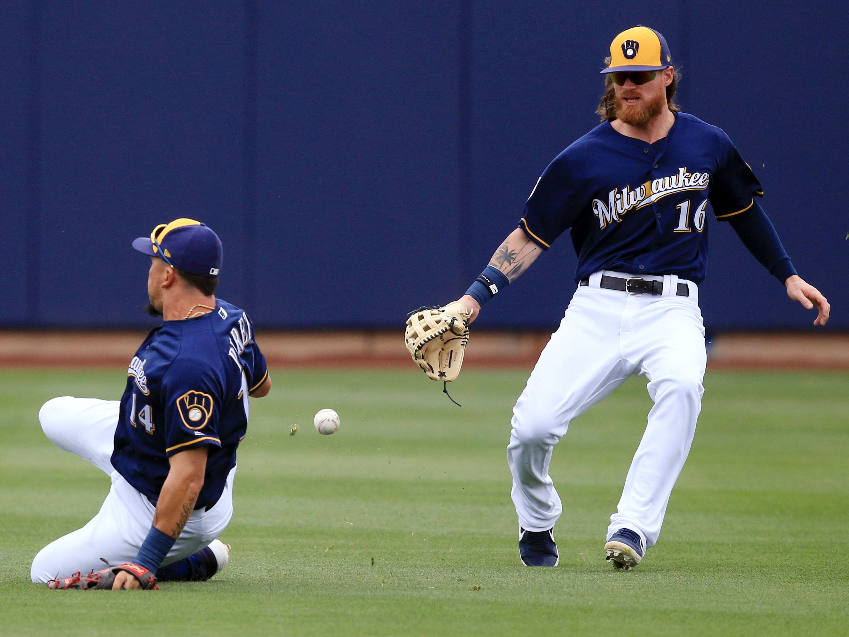 A pop fly falls between shortstop Hernan Perez and centerfielder Ben Gamel during the the Brewers' game against the Dodgers on Thursday.