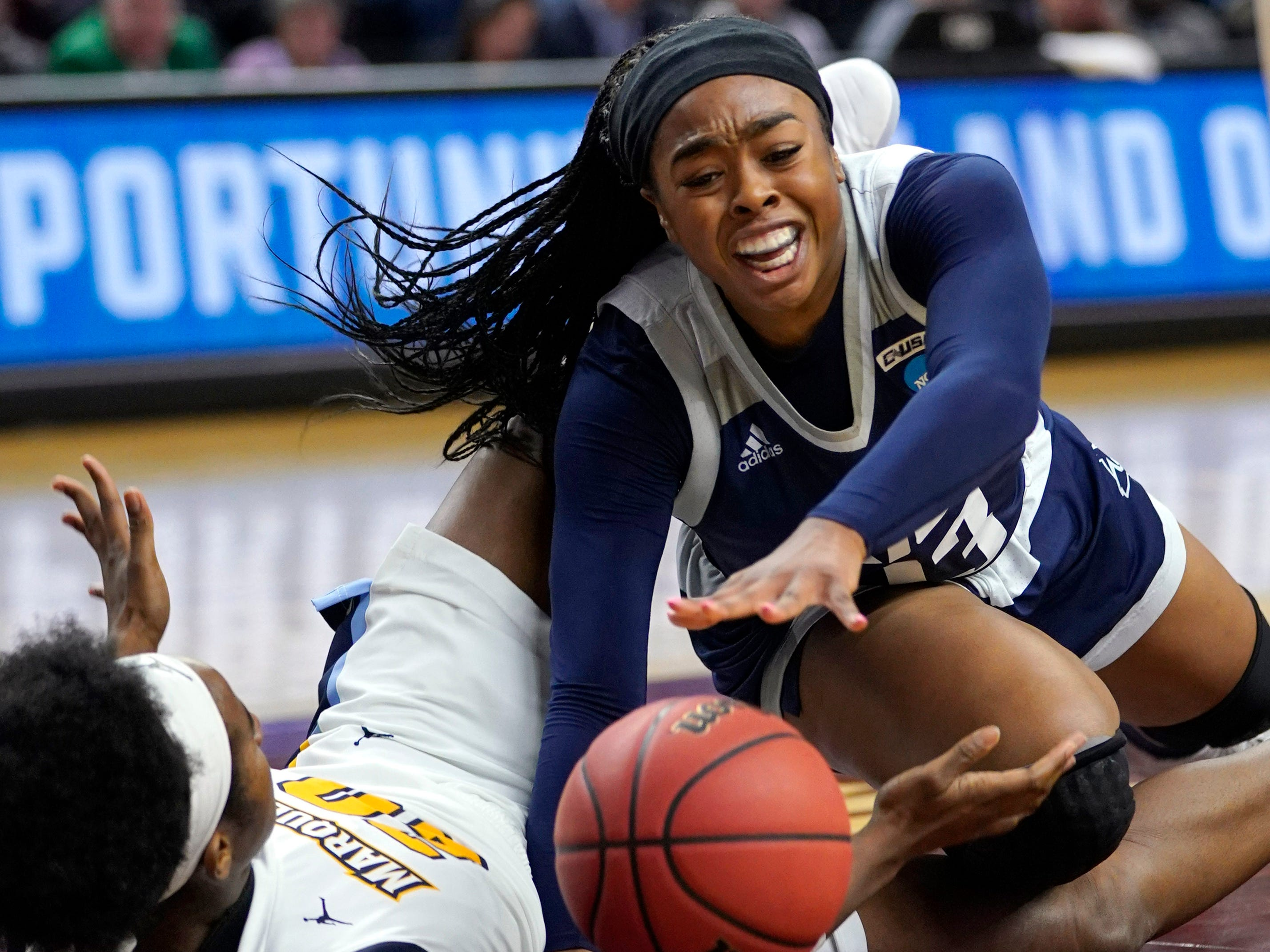 Rice's Erica Ogwumike (right) and Marquette's Altia Anderson scramble for a loose ball during the second half Friday.